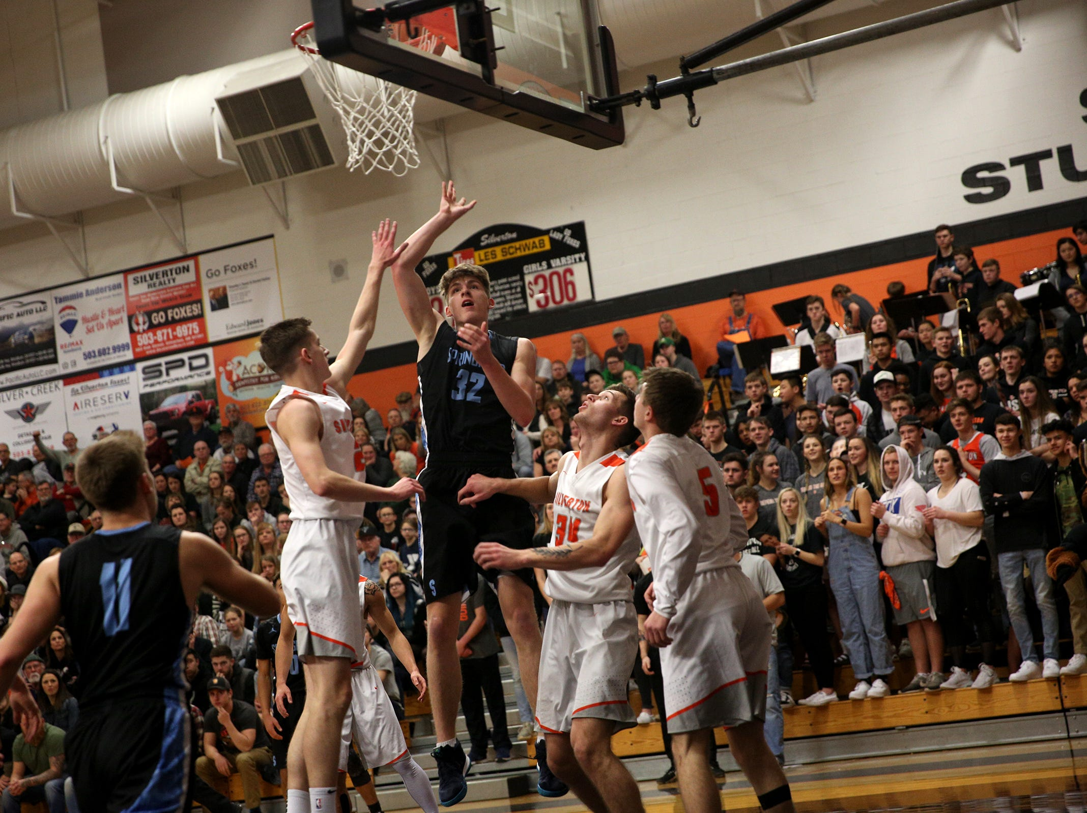 Springfield's Zach Brown (32) goes up for a shot during the Silverton vs. Springfield boys basketball OSAA state playoffs game at Silverton High School in Silverton on Saturday, March 2, 2019.