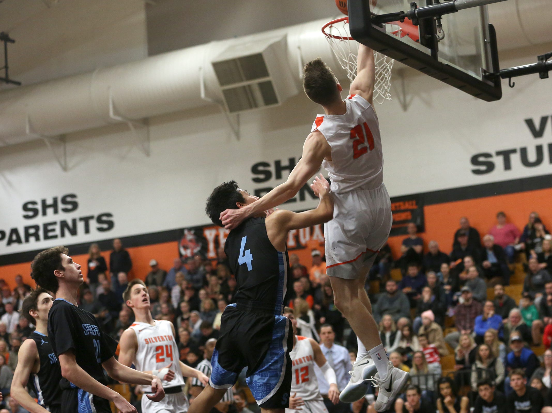 Silverton's Josiah Roth (21) dunks the ball during the Silverton vs. Springfield boys basketball OSAA state playoffs game at Silverton High School in Silverton on Saturday, March 2, 2019.