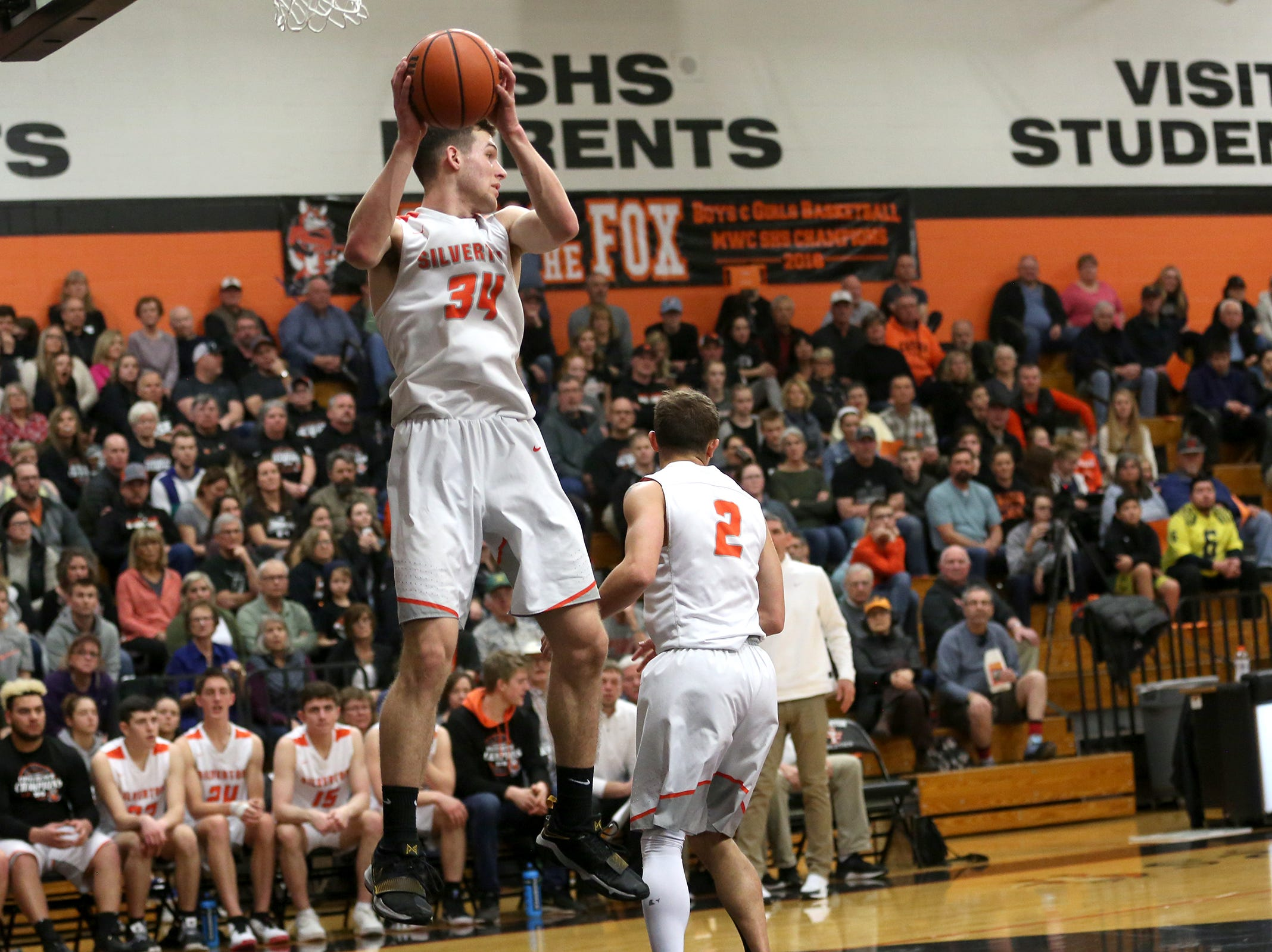 Silverton's Levi Nielsen (34) rebounds the ball during the Silverton vs. Springfield boys basketball OSAA state playoffs game at Silverton High School in Silverton on Saturday, March 2, 2019.