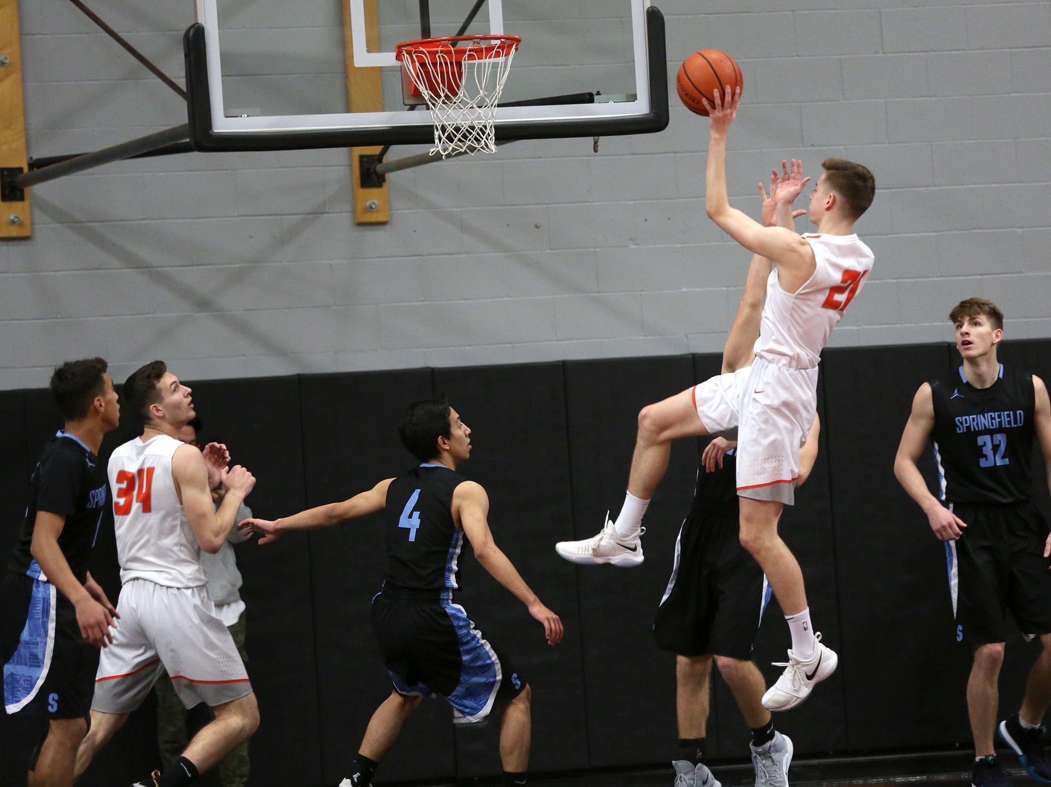 Silverton's Josiah Roth (21) goes up for a shot during the Silverton vs. Springfield boys basketball OSAA state playoffs game at Silverton High School in Silverton on Saturday, March 2, 2019.