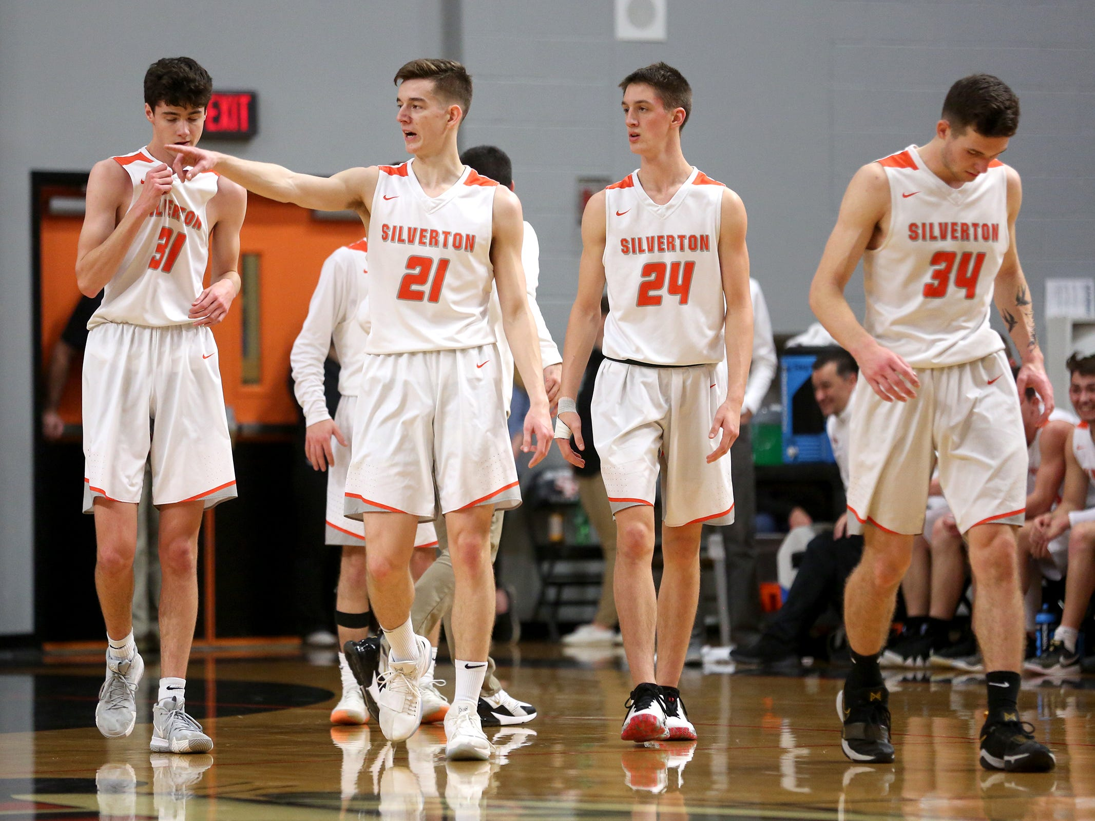 Silverton teammates during the Silverton vs. Springfield boys basketball OSAA state playoffs game at Silverton High School in Silverton on Saturday, March 2, 2019.