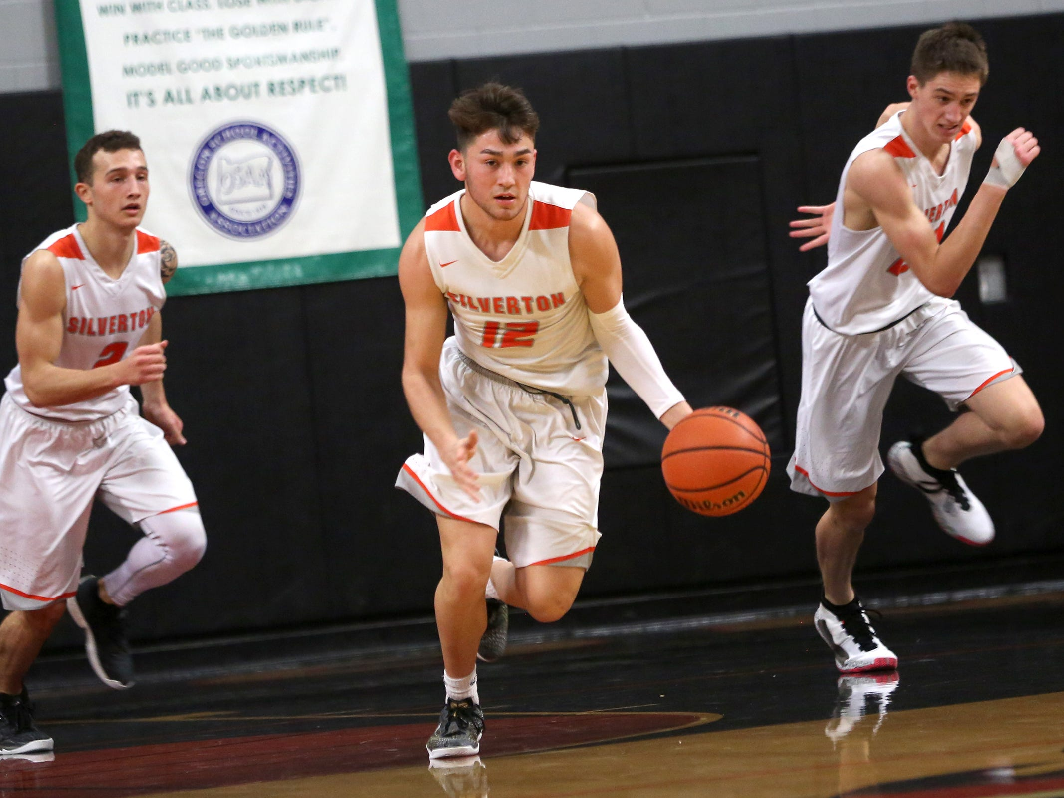 Silverton's David Gonzales (12) makes his way across the court during the Silverton vs. Springfield boys basketball OSAA state playoffs game at Silverton High School in Silverton on Saturday, March 2, 2019.
