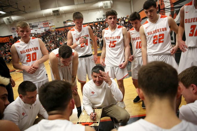 Silverton's head coach Jamie McCarty talks to his team at the bench during the Silverton vs. Springfield boys basketball OSAA state playoffs game at Silverton High School in Silverton on Saturday, March 2, 2019.