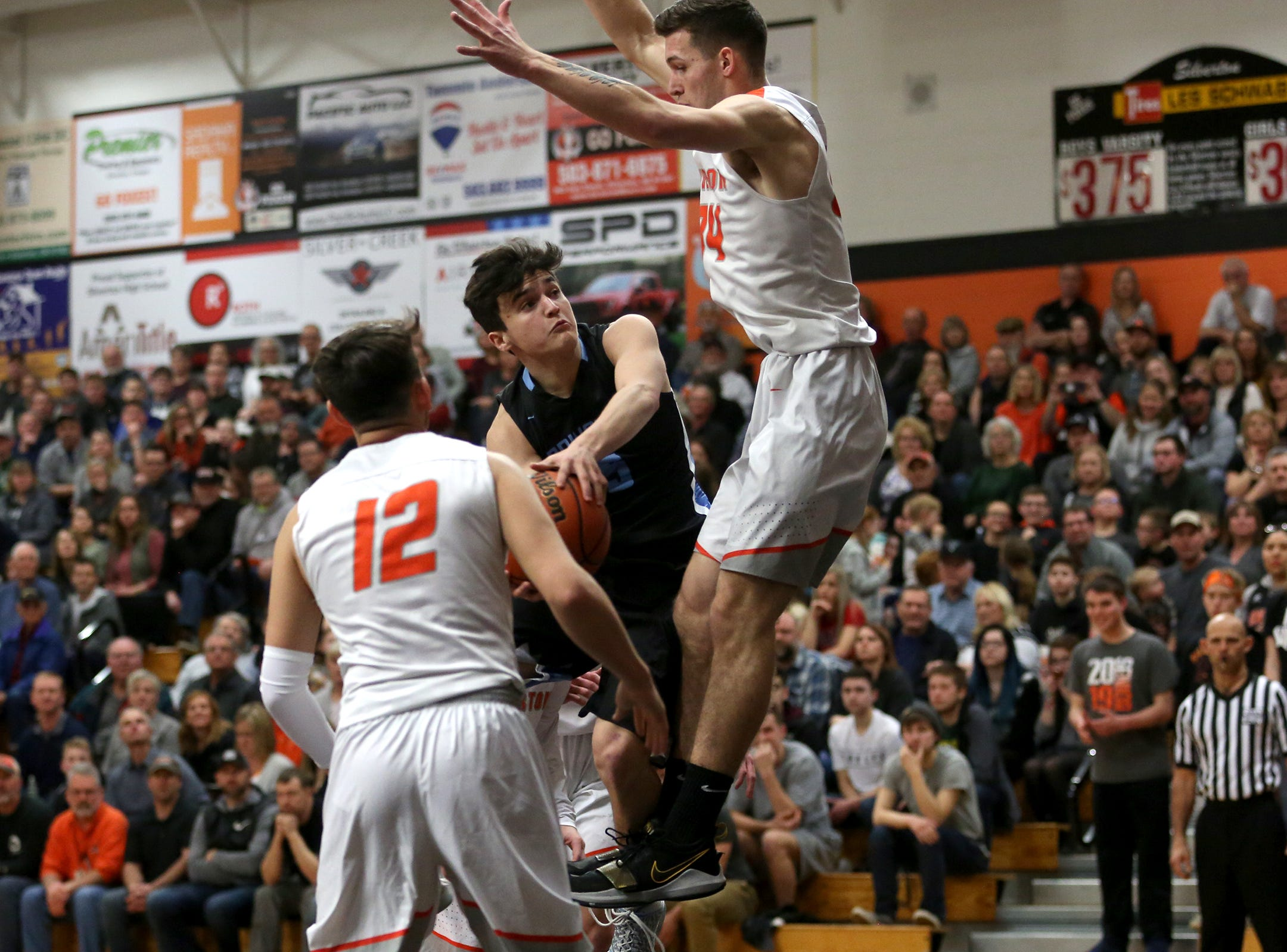 Springfield's Zack Sorber (5) attempts to get around Silverton's defense during the Silverton vs. Springfield boys basketball OSAA state playoffs game at Silverton High School in Silverton on Saturday, March 2, 2019.