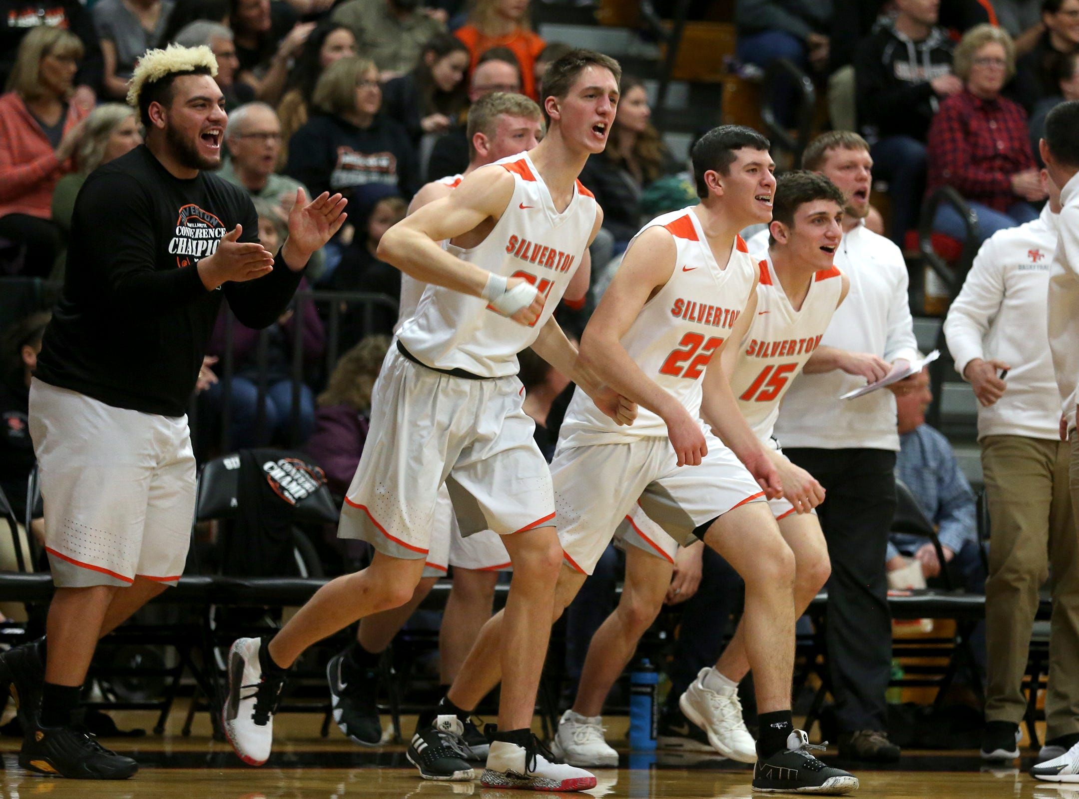 Silverton's bench cheers on their team during the Silverton vs. Springfield boys basketball OSAA state playoffs game at Silverton High School in Silverton on Saturday, March 2, 2019.