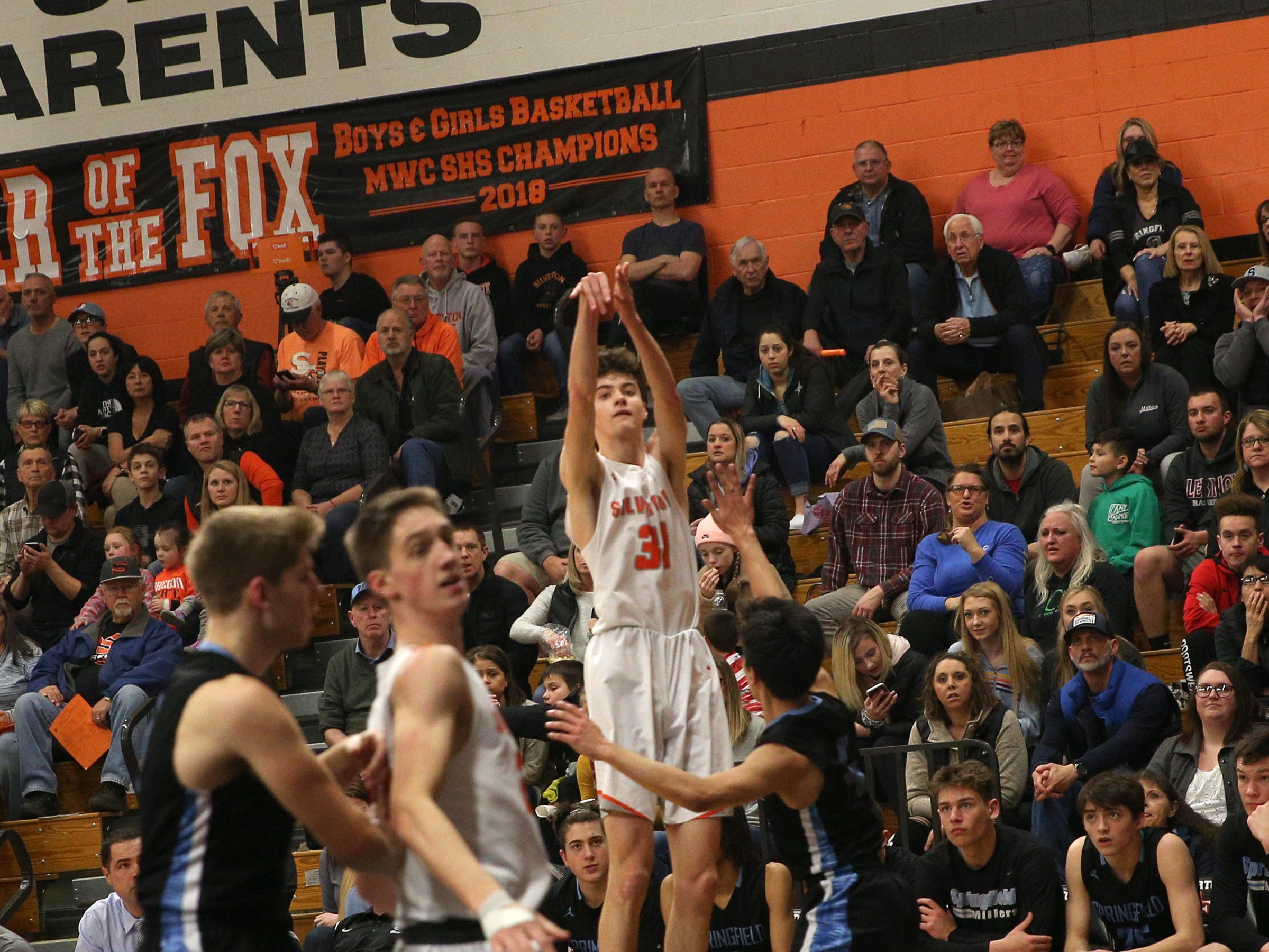 Silverton's Grant Dunn (31) attempts a 3-point shot during the Silverton vs. Springfield boys basketball OSAA state playoffs game at Silverton High School in Silverton on Saturday, March 2, 2019.