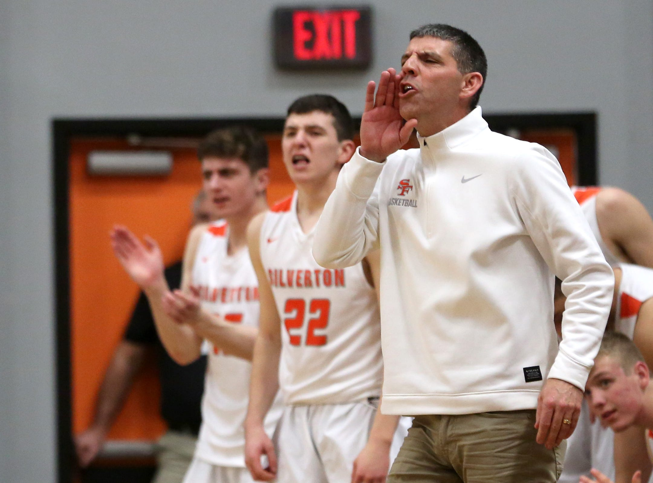 Silverton's head coach Jamie McCarty calls out a play during the Silverton vs. Springfield boys basketball OSAA state playoffs game at Silverton High School in Silverton on Saturday, March 2, 2019.
