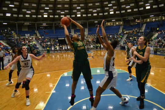 Kiayra Ellis (30) puts up a shot for Captain Shreve in the 5A girls state championship game against Denham Springs Saturday at the 2019 Allstate Sugar Bowl/LHSAA State Championship at the Rapides Parish Coliseum in Alexandria.