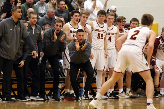 Head Coach, Mitch Begeman and the Roosevelt bench cheer on their team during Saturday's SoDak 16 state qualifier against Washington in Sioux Falls.