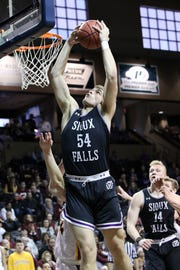 Devin Green of USF snags a rebound over a Northern State player during Sunday's NSIC quarterfinal game at the Pentagon.