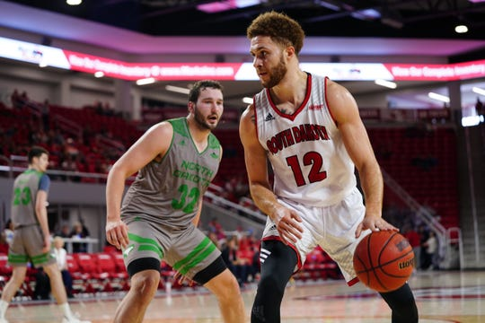 South Dakota senior Trey Burch-Manning looks to move the ball during Saturday's game against North Dakota. Saturday's game was the final home game for the Coyote seniors.