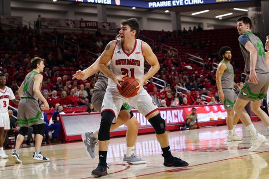 South Dakota senior Dan Jech turns towards the basket against North Dakota on Saturday, March 2, 2019. Saturday's game was the final home game for the Coyote seniors.