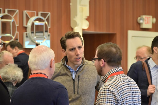 Sen. Josh Hawley, R-Mo., talks with supporters at the Missouri Republican Party's Lincoln Days Saturday, March 2, 2019 in Maryland Heights, Mo. Hawley decried congressional Democrats' support for abortion rights and opposition to Republicans' border security plans in remarks at breakfast.