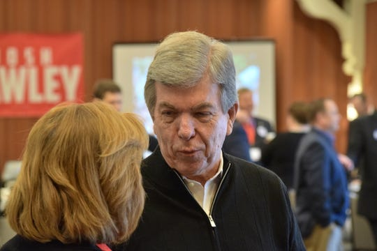 Sen. Roy Blunt, R-Mo., talks with a supporter at the Missouri Republican Party's Lincoln Days Saturday, March 2, 2019 in Maryland Heights, Mo. In remarks at breakfast, Blunt said he was working to make it easier to confirm President Donald Trump's judicial nominees.