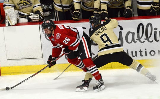 St. Cloud State sophomore Easton Brodzinski carries the puck past Western Michigan's Dawson Dipietro in Saturday's NCHC game.