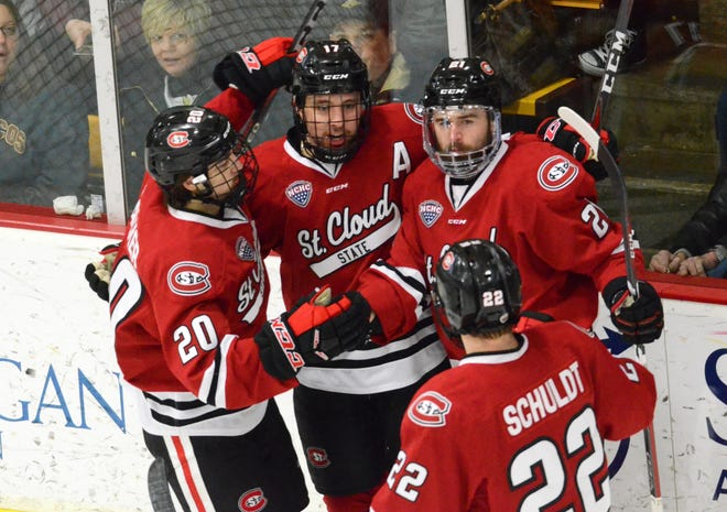 St. Cloud State players gather to celebrate a goal against Western Michigan in Saturday's NCHC contest.