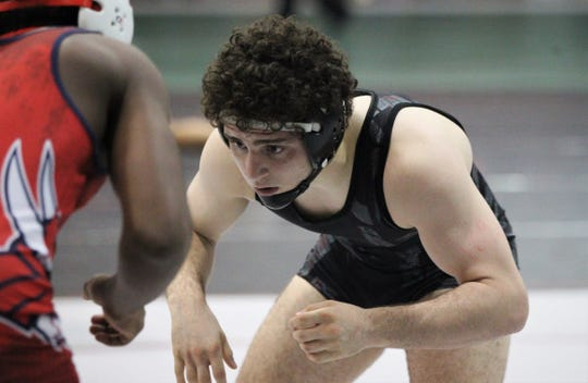 Chiles sophomore Kyle McGill wrestles a 170-pound semifinal match at the Region 1-2A wrestling tournament at Chiles on March 2, 2019.
