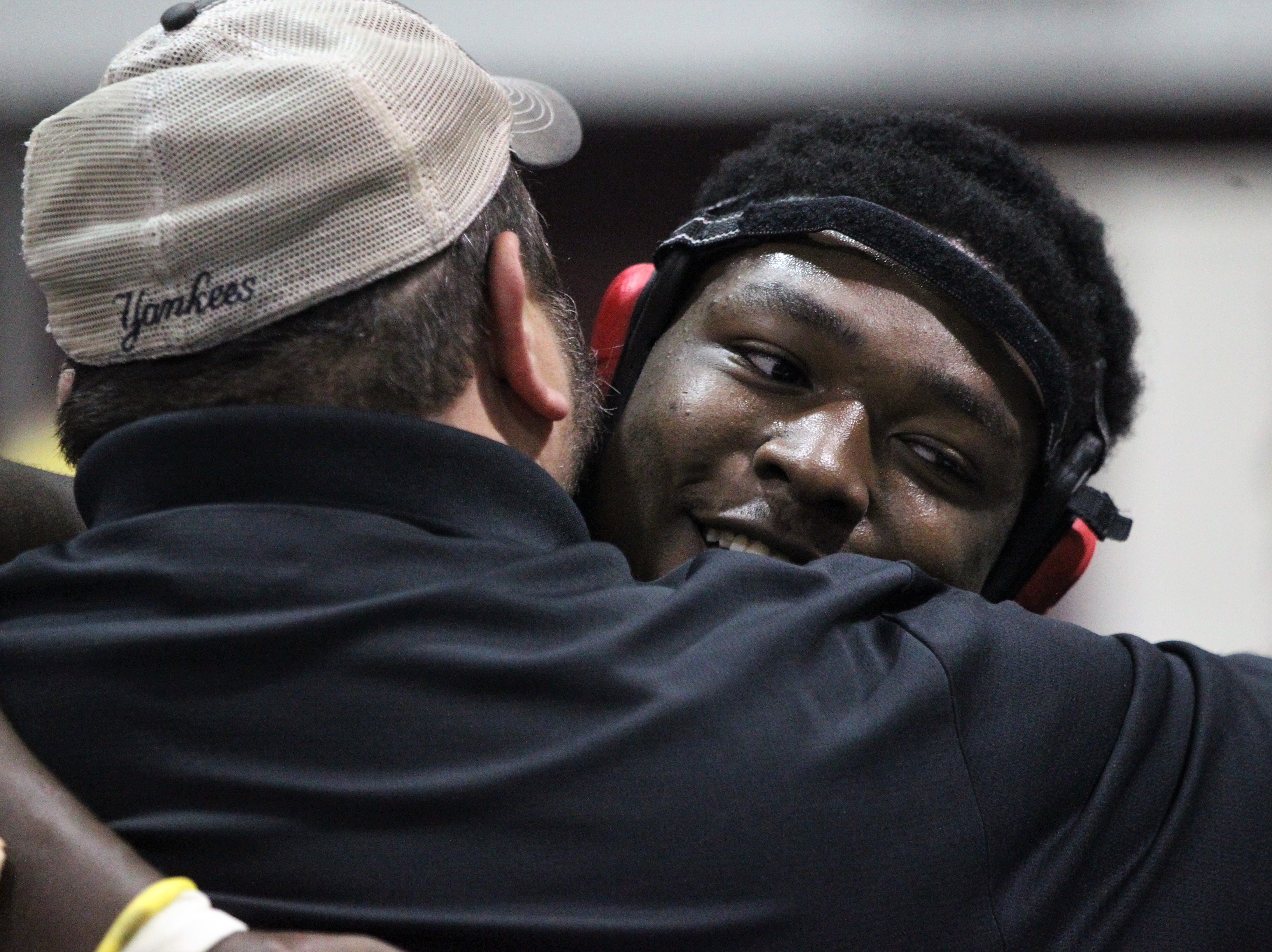 Leon sophomore Josh Seabrooks hugs Lions wrestling coach Chuck Ringel after Seabrooks qualified for the state tournament at 220 pounds despite being a first-year wrestler. Region 1-2A wrestling tournament at Chiles on March 2, 2019.