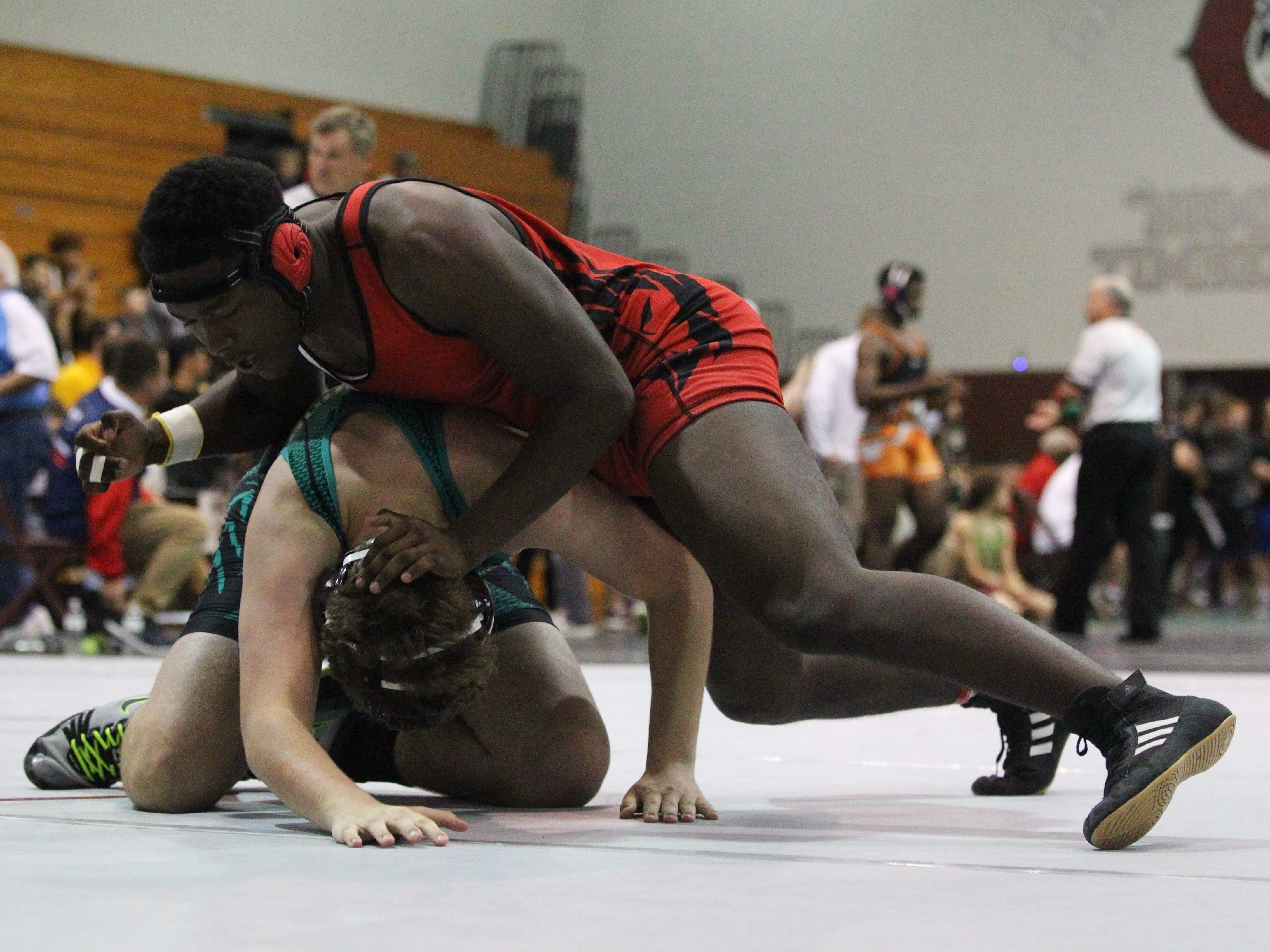 Leon's Josh Seabrooks wrestles Lincoln's Wyatt Yown in the blood round at the Region 1-2A wrestling tournament at Chiles on March 2, 2019.
