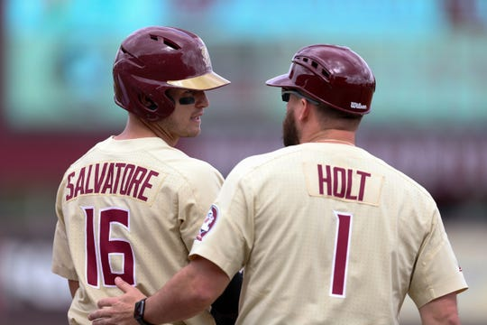 Florida State University Mike Salvatore (16) talks with Undergraduate Assistant Coach Tyler Holt (1) at first base during a game between FSU and Mercer University at Dick Howser Stadium Sunday, March 3, 2019.