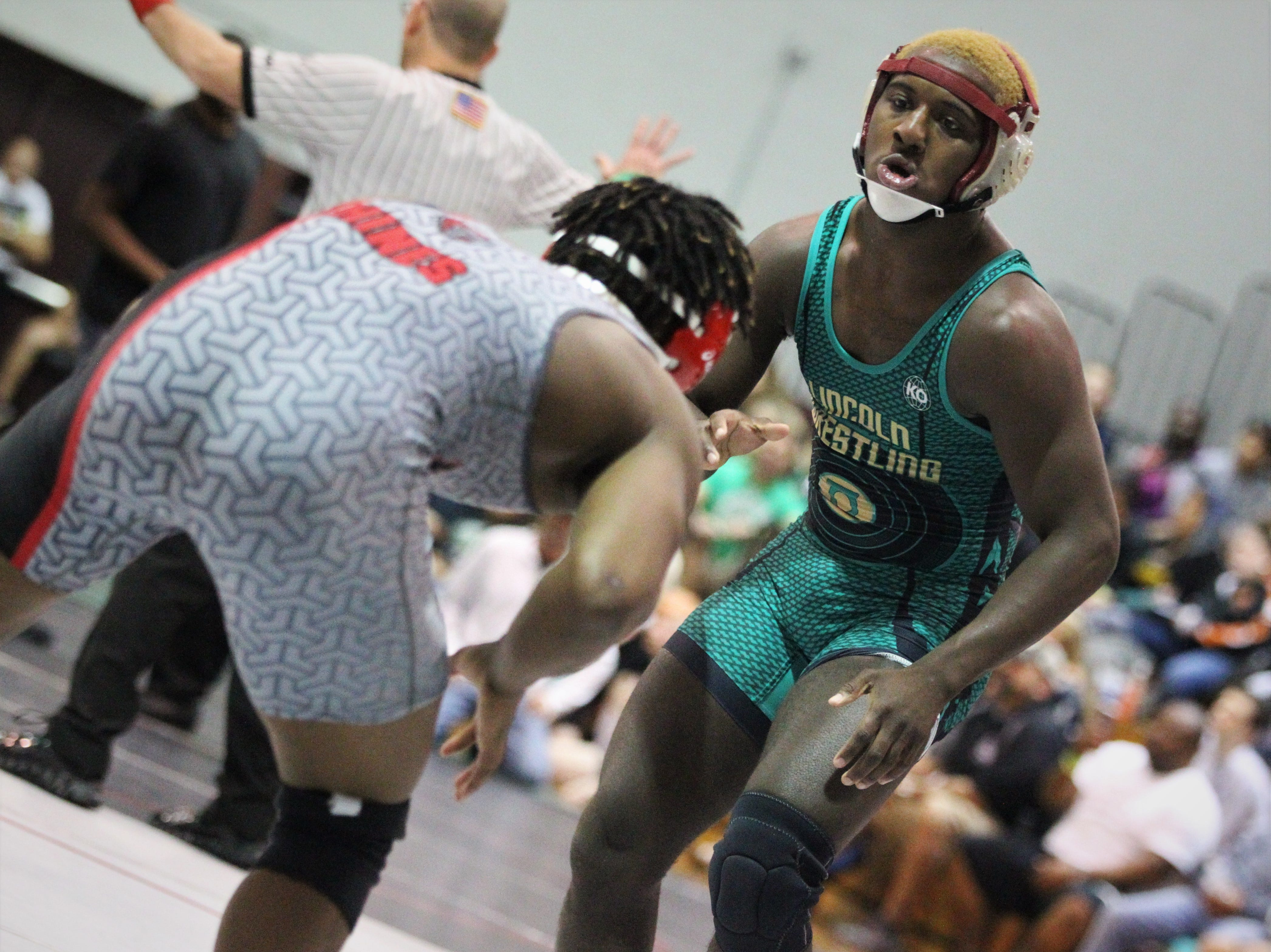 Lincoln senior Tony Davis wrestles during a 160-pound semifinal match at the Region 1-2A wrestling tournament at Chiles on March 2, 2019.