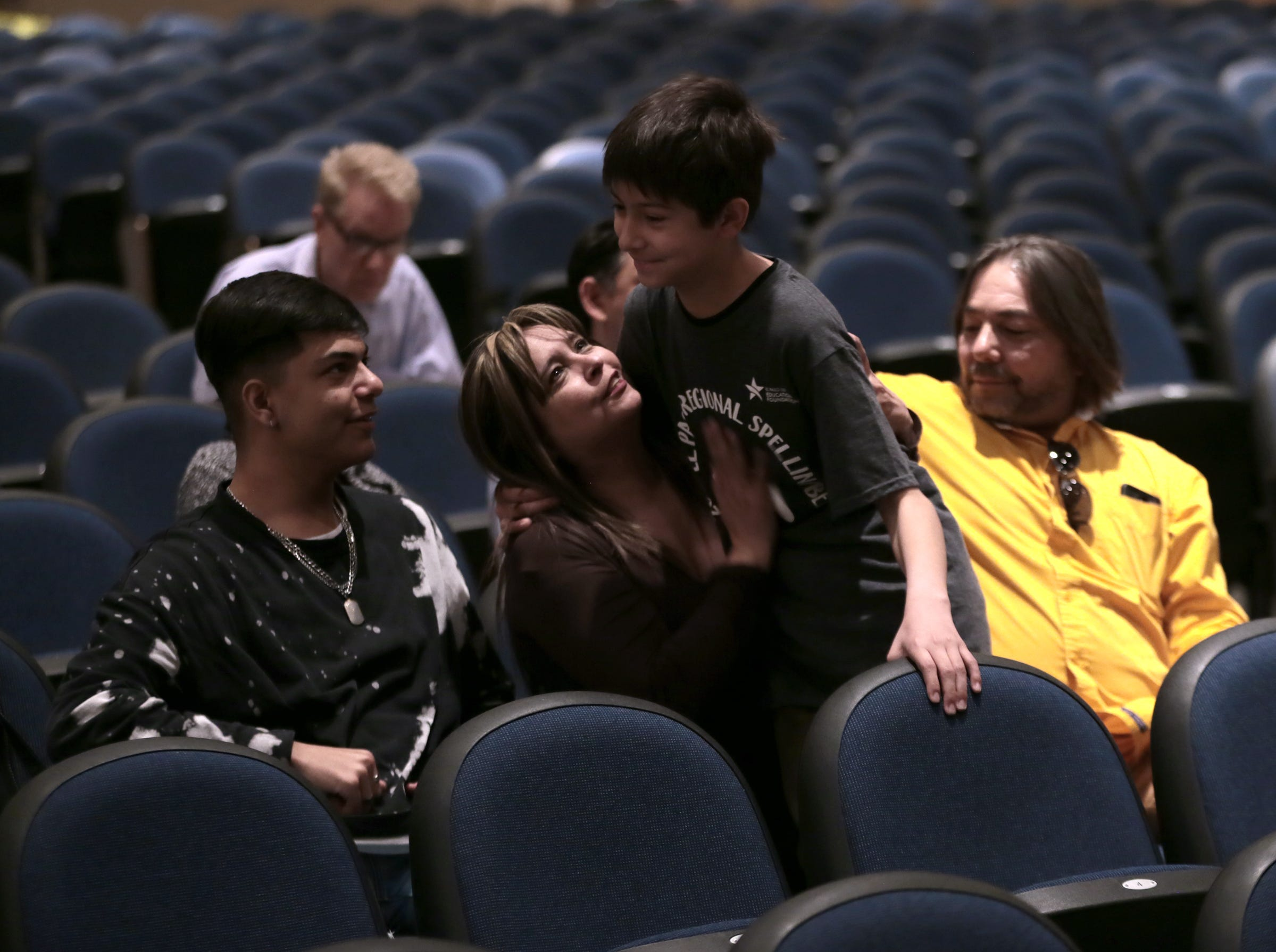 Ian Austin from Edgemere Elementary School is consoled by family after spelling his word incorrectly Saturday in the 2019 El Paso Regional Spelling Bee. Austin would finish in third place.