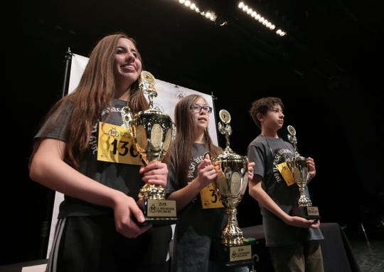 The top three finishers in the 2019 El Paso Regional Spelling Bee were second place Kristina Martos, left, second place Ian Austin, right, and first place Penelope Moore.