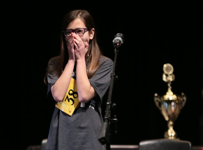 Penelope Moore from Lincoln Middle School reacts after spelling 'geniture' correctly to win the 2019 El Paso Regional Spelling Bee.