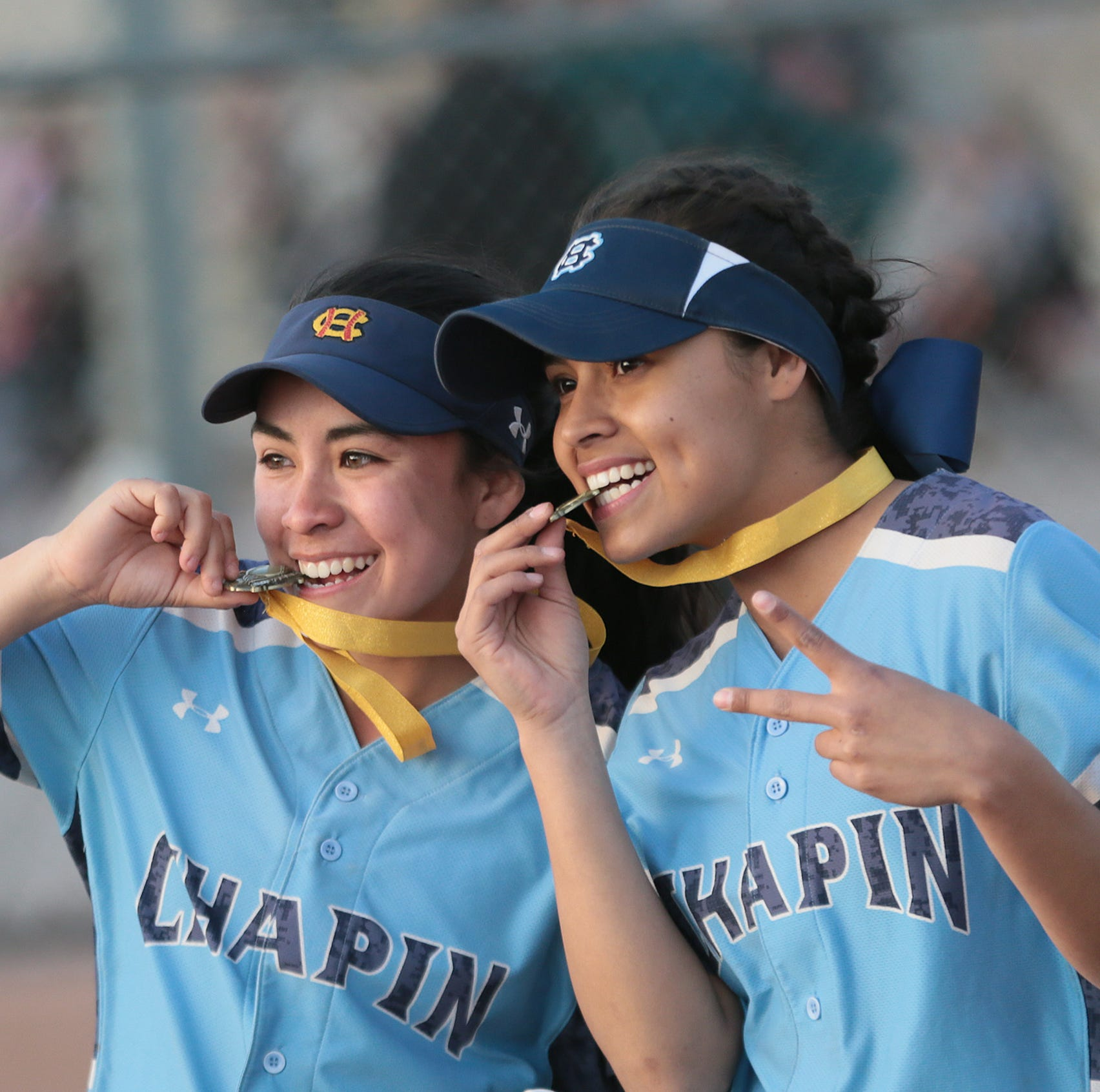 Chapin High School players celebrate after defeating Bushland High School 9-2 in March to win the Fox Country Fast Pitch Softball Tournament at the Northeast Regional Park.