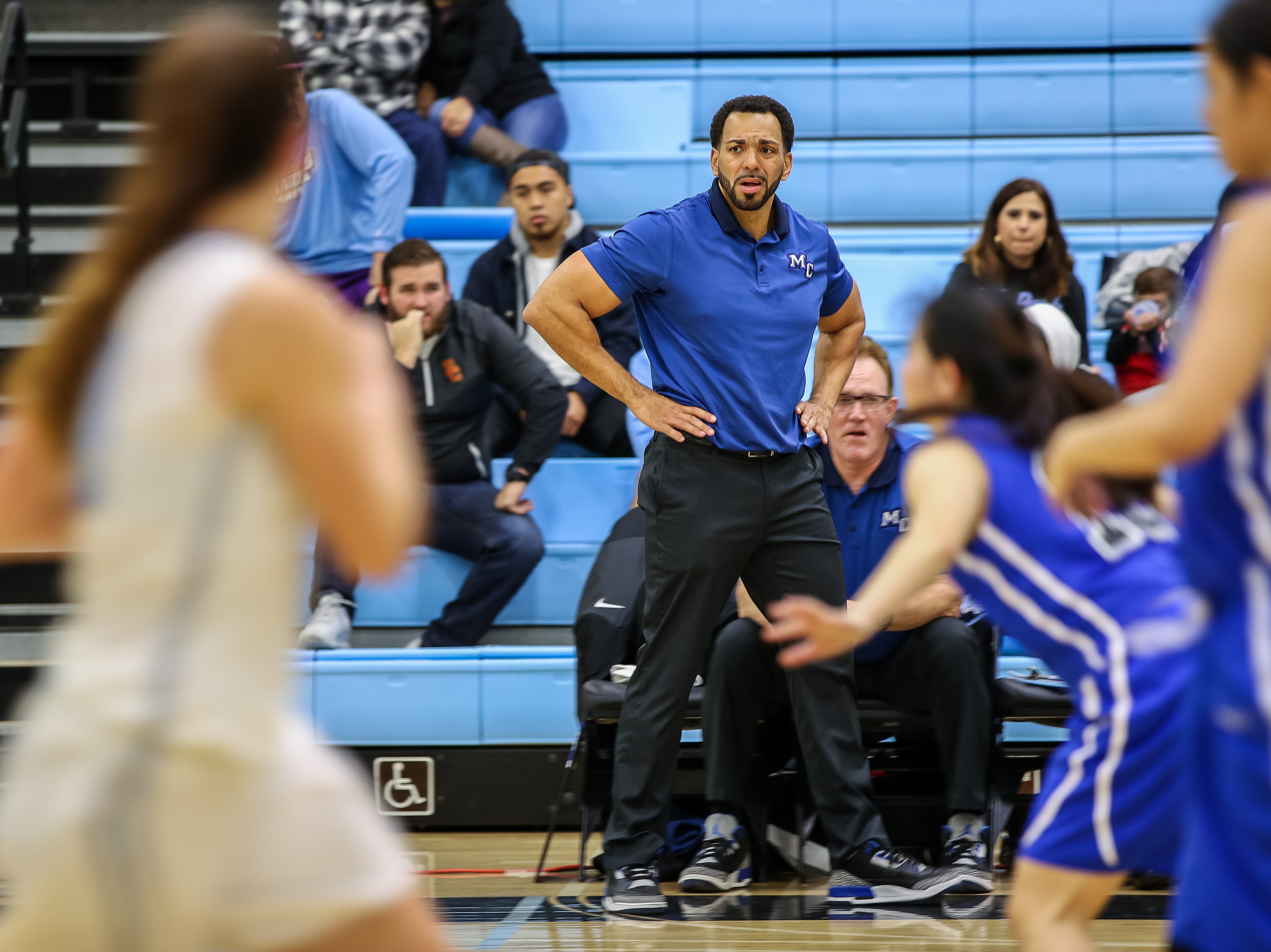 Moorpark College head coach Kenny Plummer reacts as his team brings the ball up court after giving up a basket during the Raiders' 86-56 win over Cerritos in a Southern California regional semifinal game Saturday night at Moorpark College.