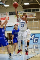 Moorpark College's Breanna Calhoun floats a shot to the basket during the Raiders' 86-56 win over Cerritos in a Southern California regional semifinal game Saturday night at Moorpark College.