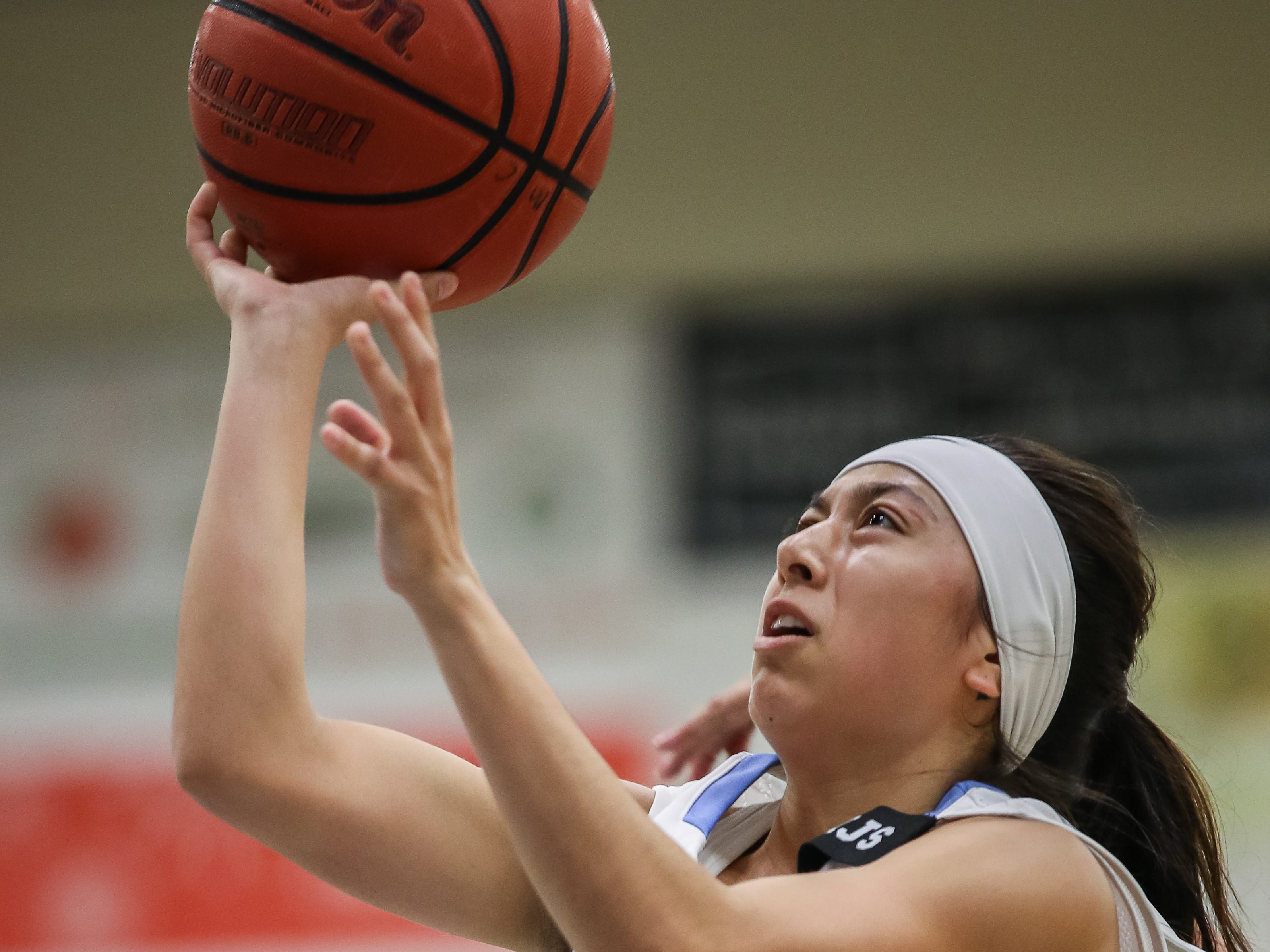 Moorpark College's Jazzy Carrasco goes to the basket during the Raiders' 86-56 win over Cerritos in a Southern California regional semifinal game Saturday night at Moorpark College. Carrasco scored a game-high 21 points.