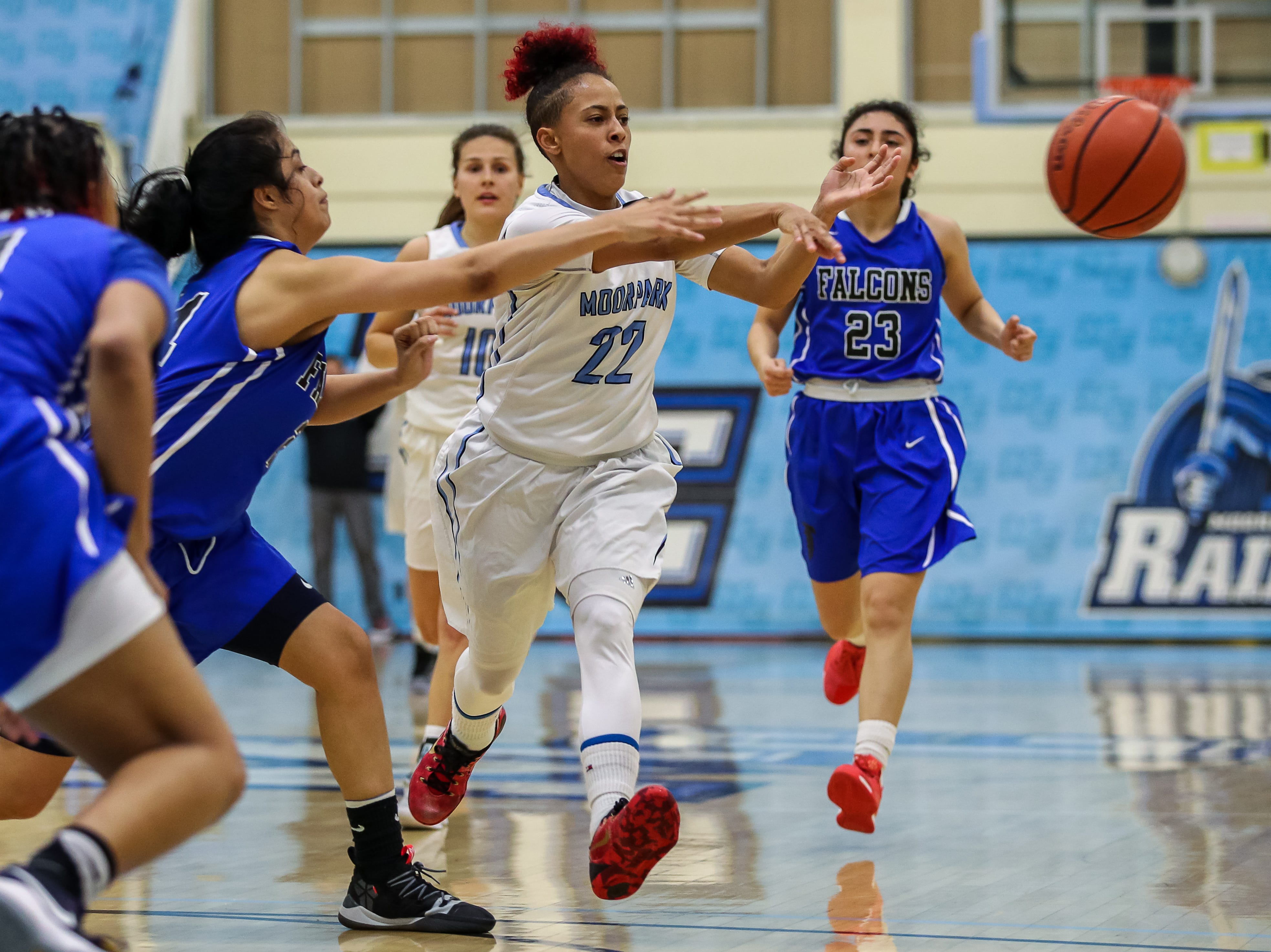 Moorpark College's Breanna Calhoun passes the ball during the Raiders' 86-56 win over Cerritos in a Southern California regional semifinal game Saturday night at Moorpark College.