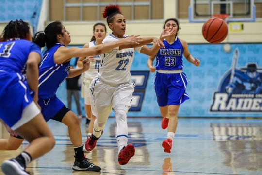 Moorpark College's Breanna Calhoun passes the ball during the Raiders' 86-56 win over Cerritos in a Southern California regional semifinal game last weekend.