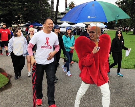 """Ryan Ong Palao, who goes by the stage name Ongina on """"RuPaul's Drag Race,"""" leads the way on Saturday during the 2019 AIDS Walk Ventura at Plaza Park in Ventura."""