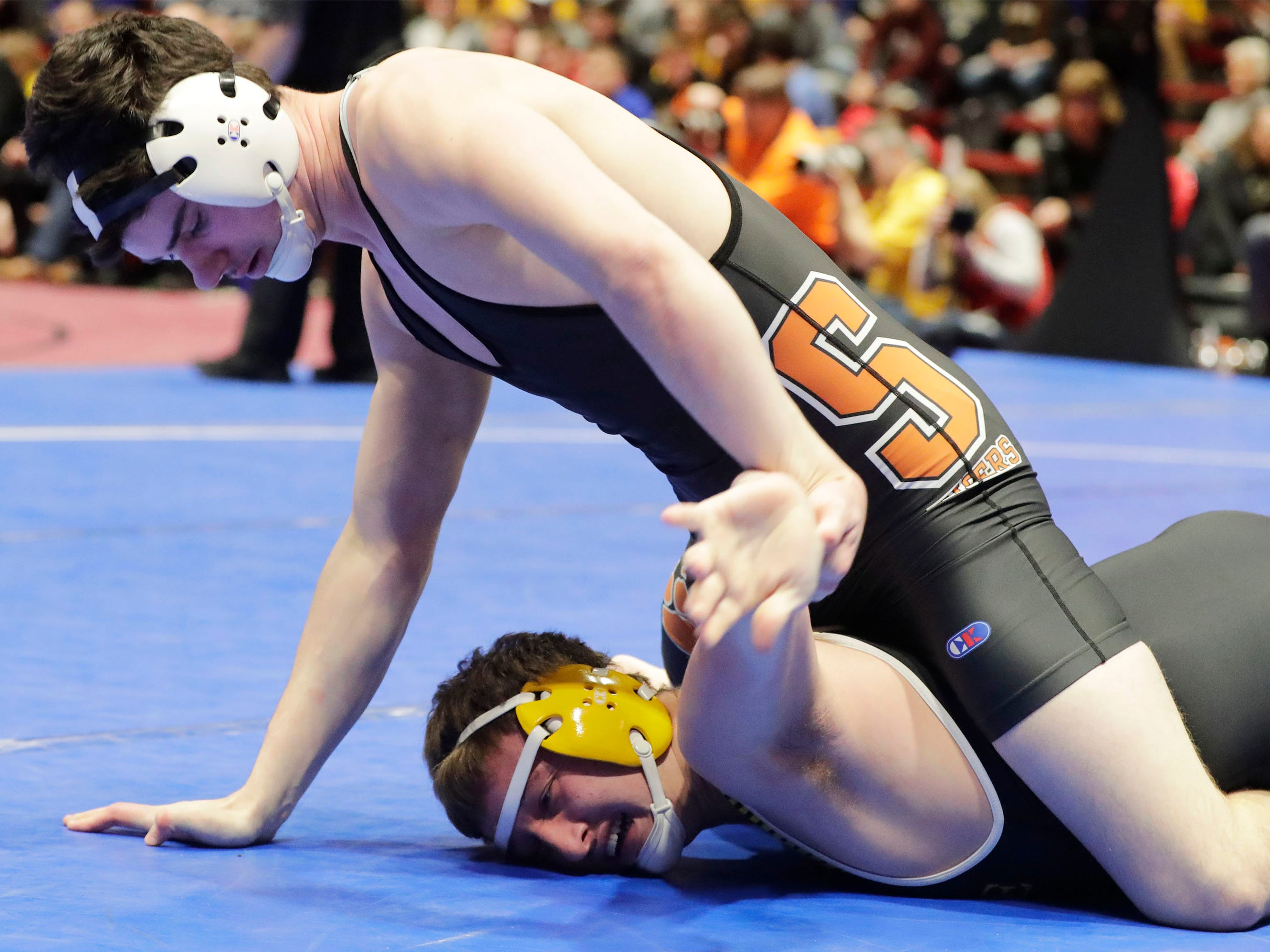 Stratford's Jediah Knetter, top, wrestles Fennimore's Logan Klass in the 195-pound class, Saturday, March 2, 2019, in Madison, Wis.