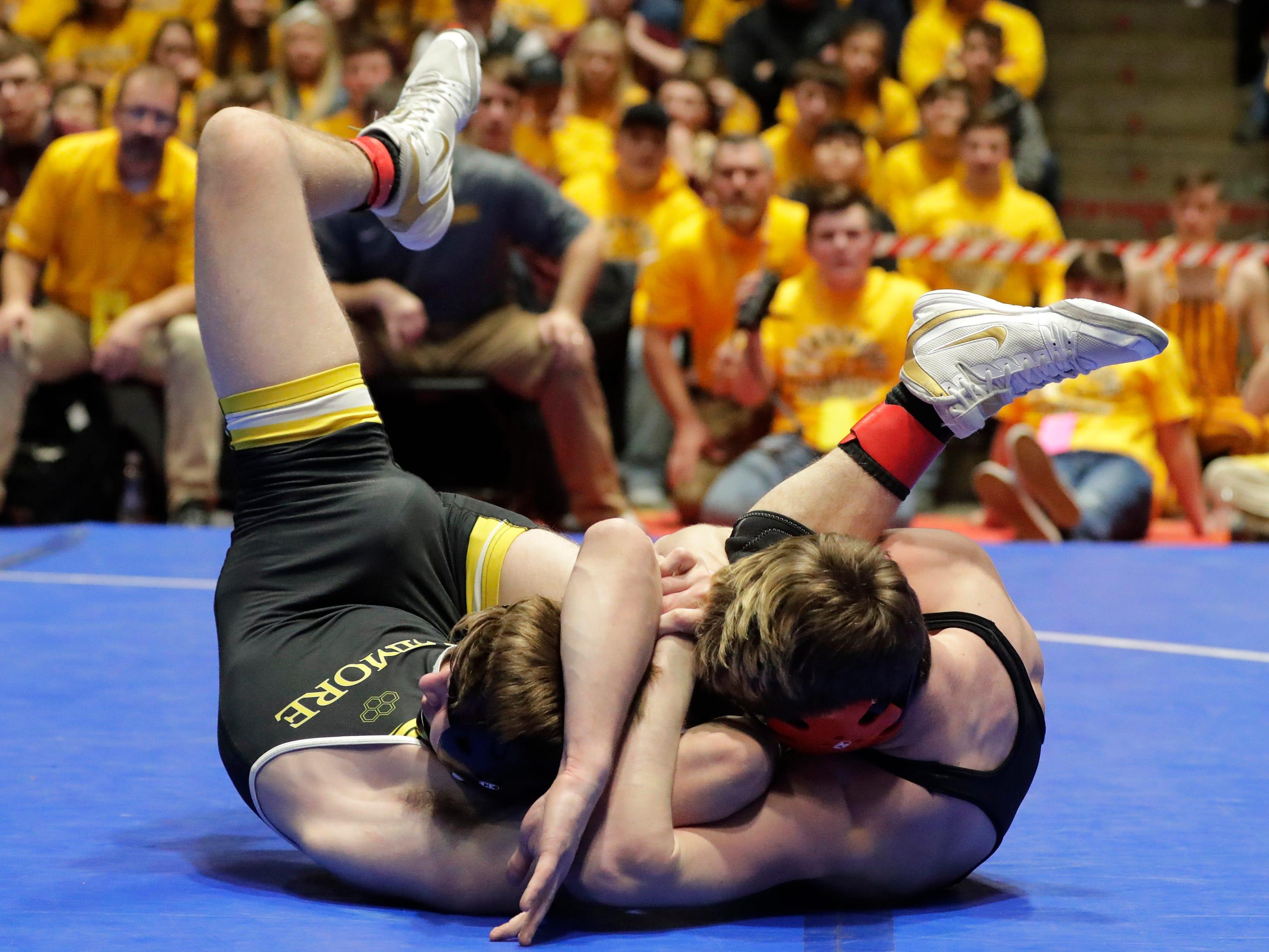 Stratford's Devin Dennee, right, wrestles Fennimore's Nick Blaschke in the 152-pound class, Saturday, March 2, 2019, in Madison, Wis.