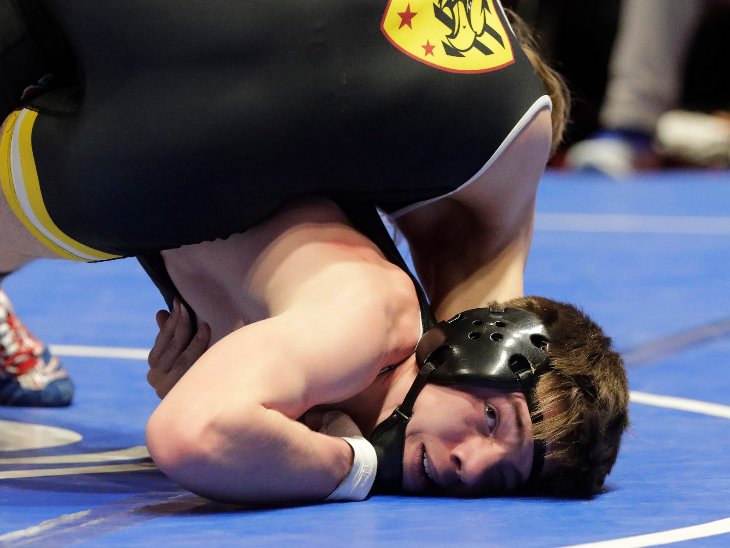 Stratford's Maverick Licciardi, bottom, looks up as he wrestles Fennimore's Trevor Wanek in the 145-pound class, Saturday, March 2, 2019, in Madison, Wis.