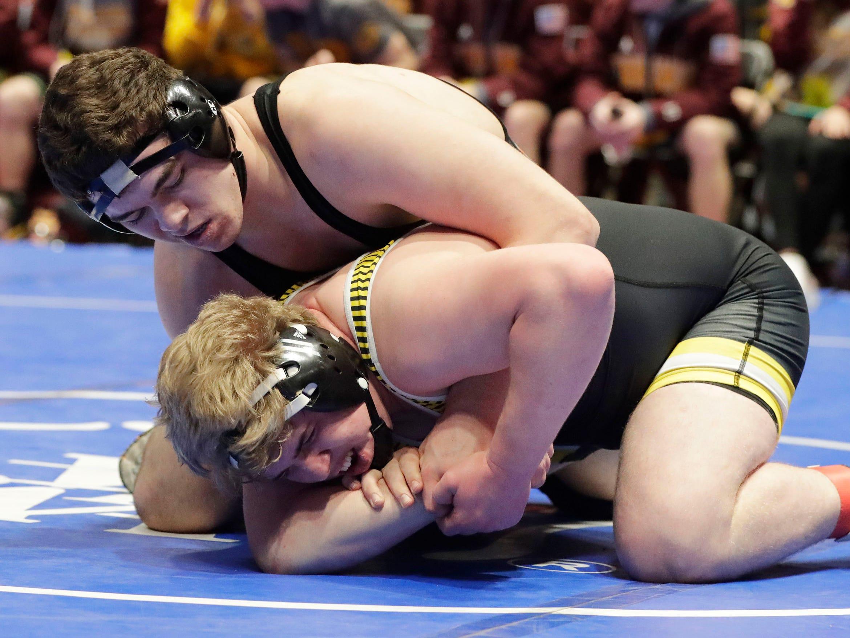 Stratford's Dylan Schoenherr, top, holds Brayden Leffler in the 285-pound class, Saturday, March 2, 2019, in Madison, Wis.