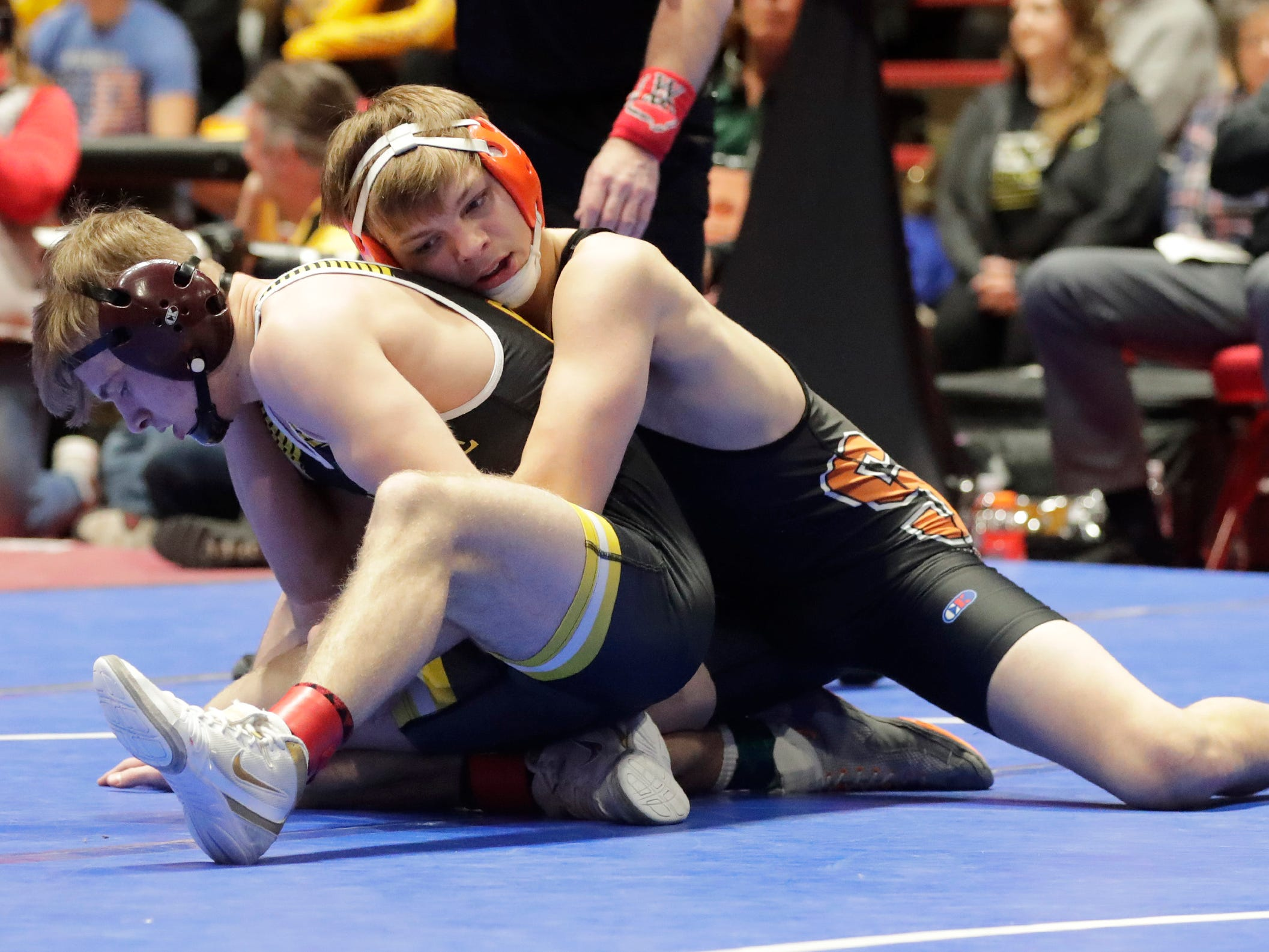 Stratford's Jacob Heiden, right, stretches out to wrestle Fennimore's Aiden Nutter in the 138-pound class, Saturday, March 2, 2019, in Madison, Wis.