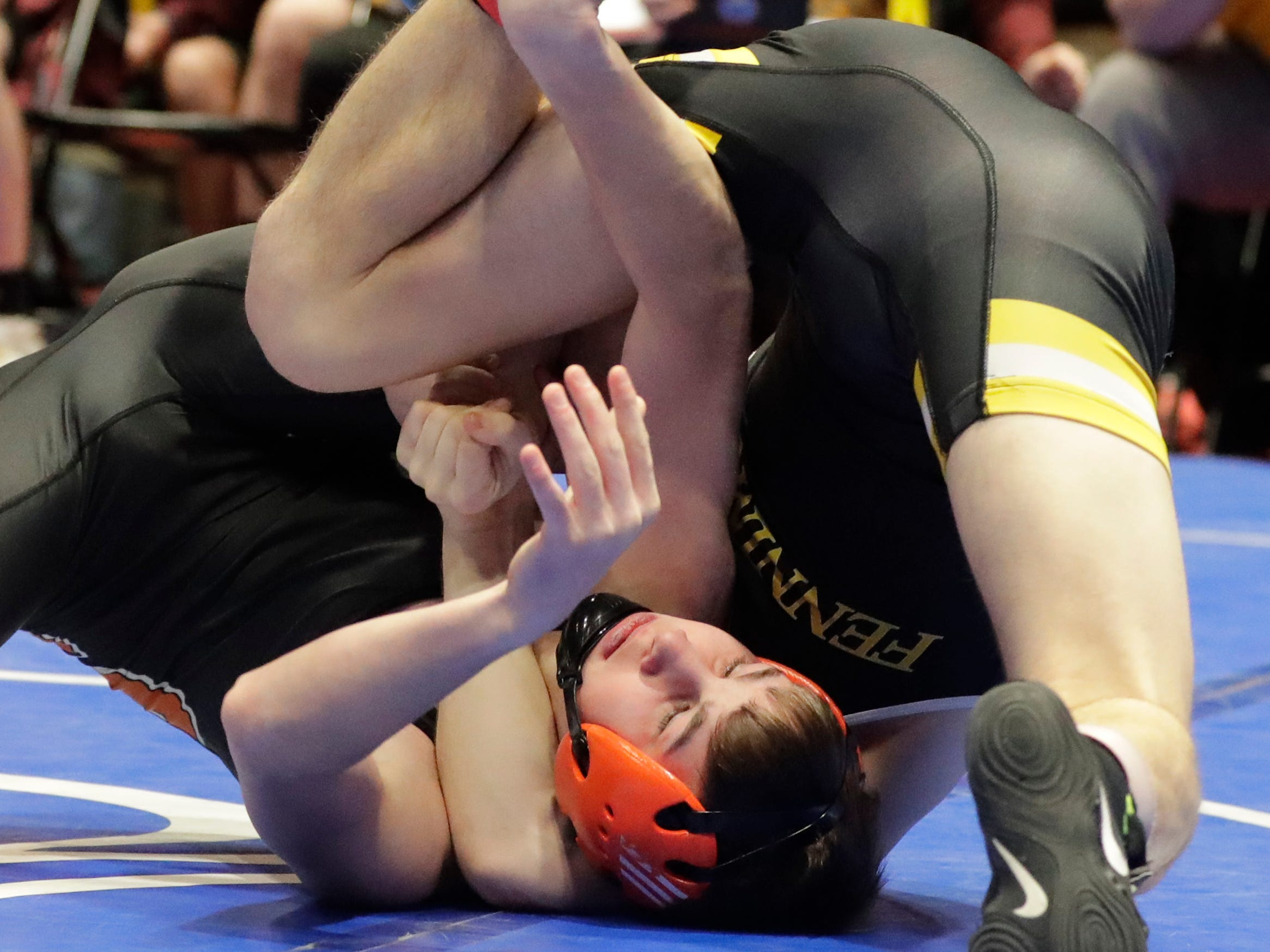 Stratford's Dillon Kirsch, bottom, is all tied up by Fennimore's Alex Birchman in the 126-pound class, Saturday, March 2, 2019, in Madison, Wis.