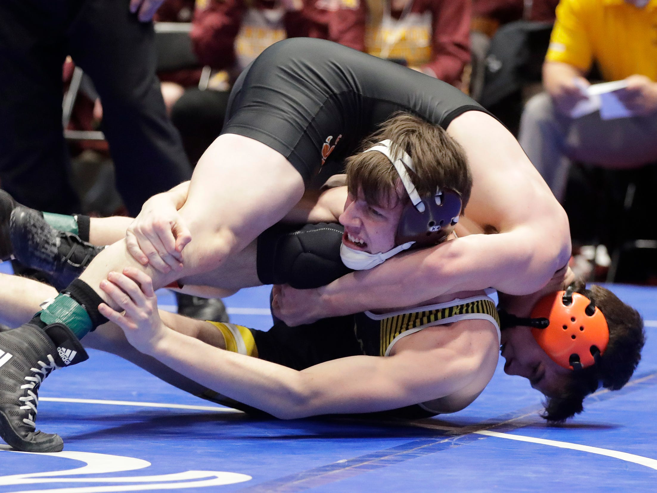Stratford's Max Schwabe, right, wrestles Fennimore's Kohl Wardell in the 132-pound class, Saturday, March 2, 2019, in Madison, Wis.