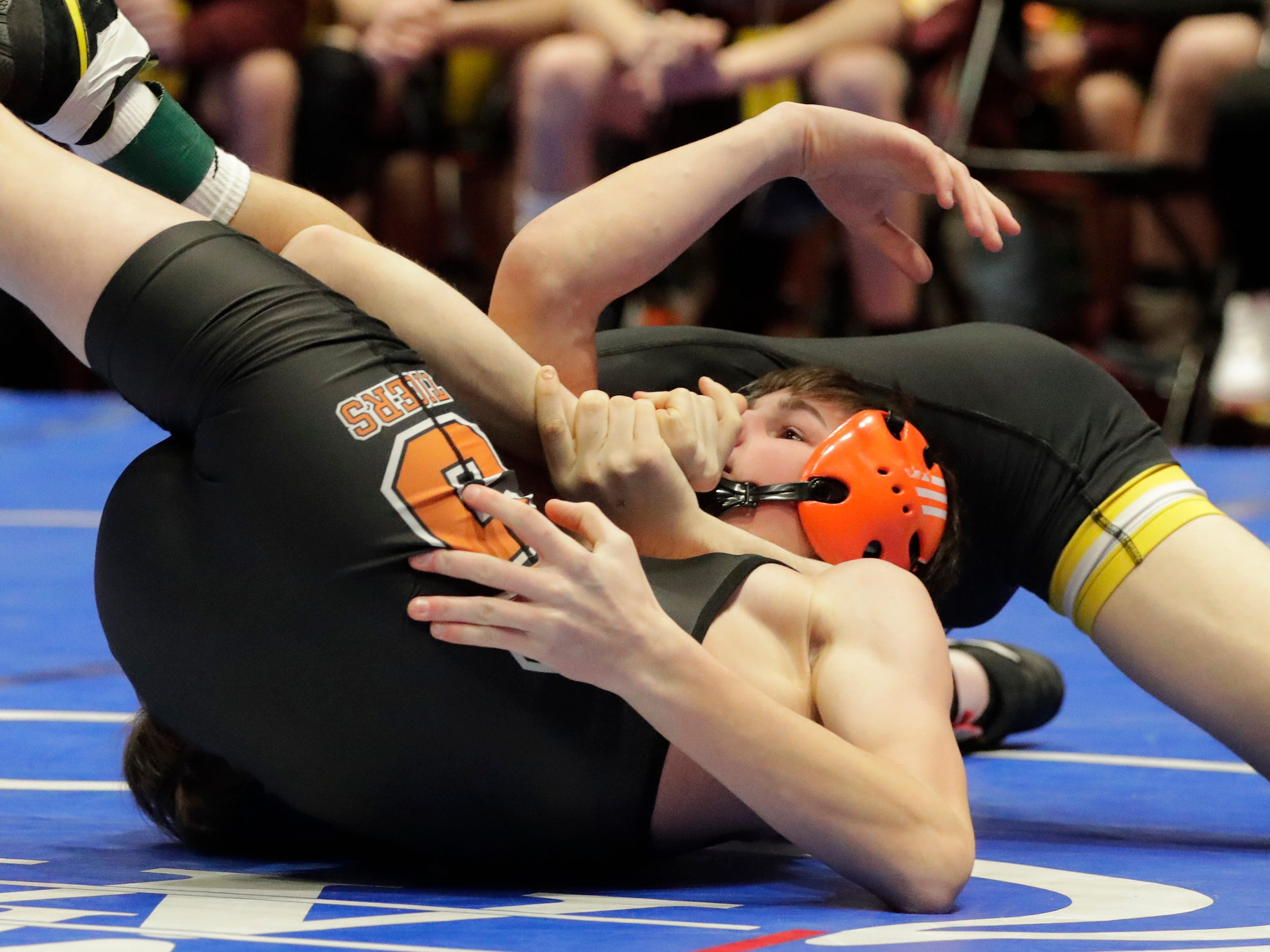 Stratford's Dillon Kirsch, bottom, is wrapped up by Fennimore's Alex Birchman in the 126-pound class, Saturday, March 2, 2019, in Madison, Wis.