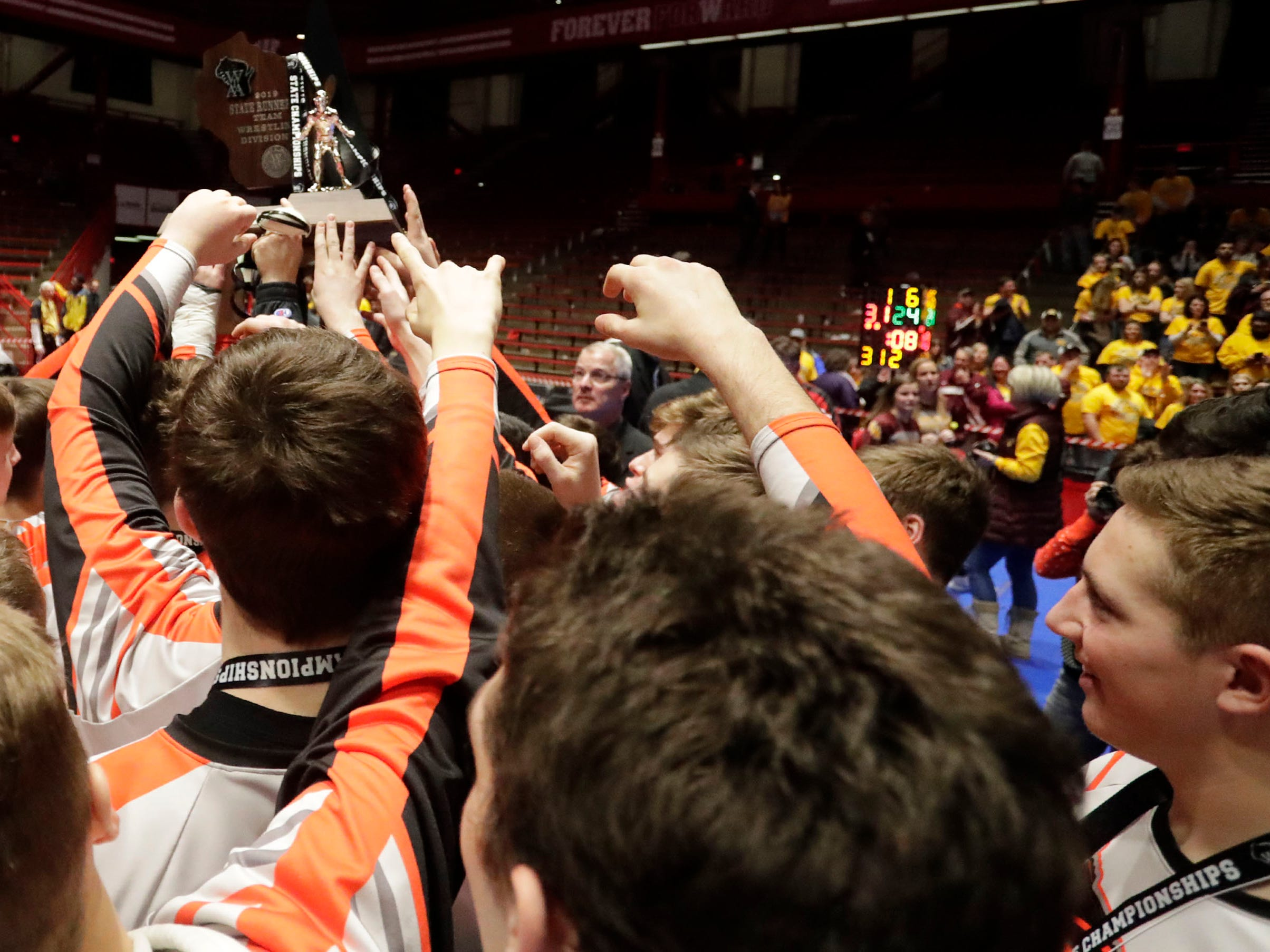 Stratford players grasp for the second place trophy after losing to Fennimore in the WIAA State team wrestling final, Saturday, March 2, 2019, in Madison, Wis.
