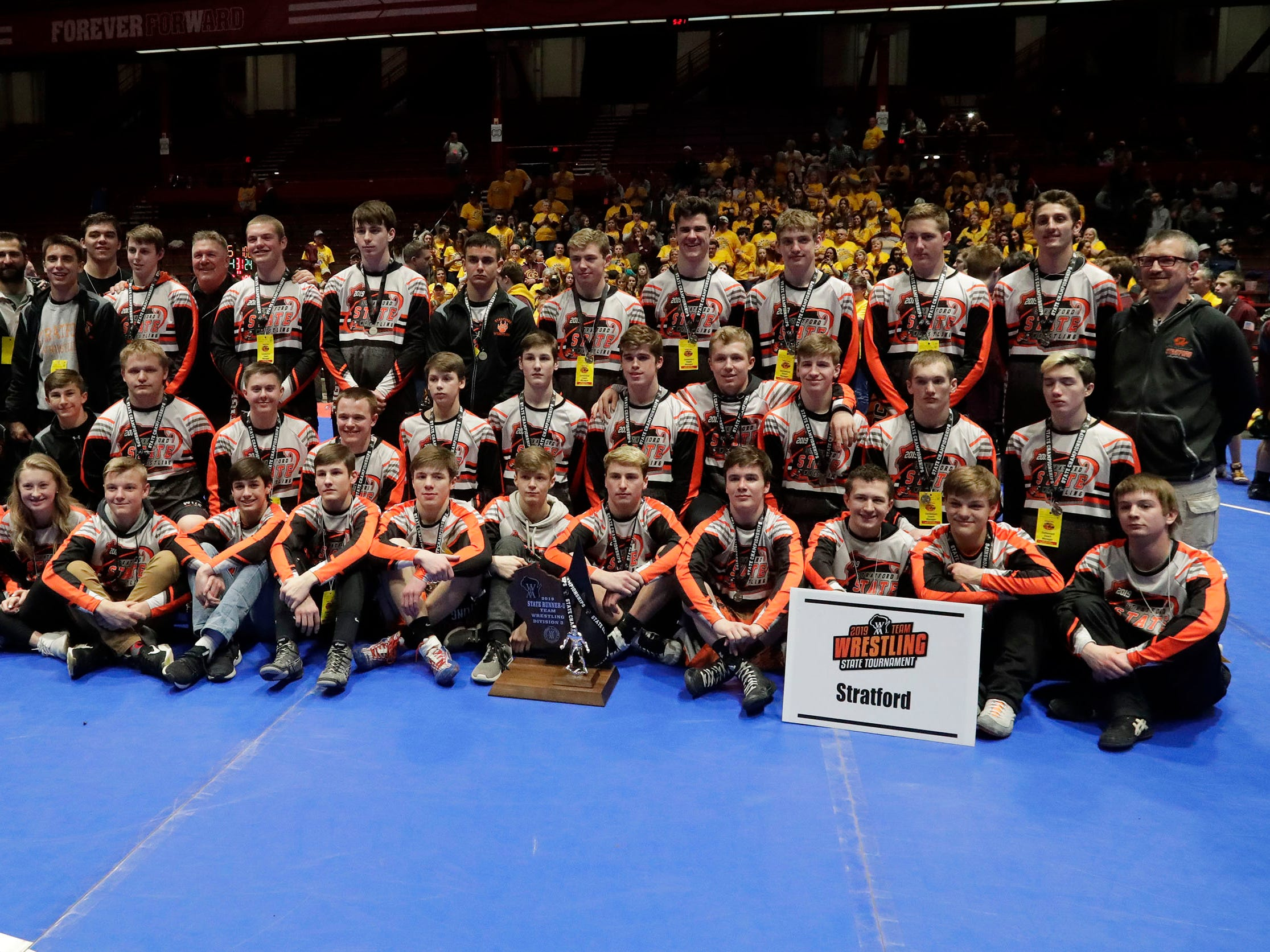 Stratford's team poses for a photo at the conclusion of their season at state, Saturday, March 2, 2019, in Madison, Wis.