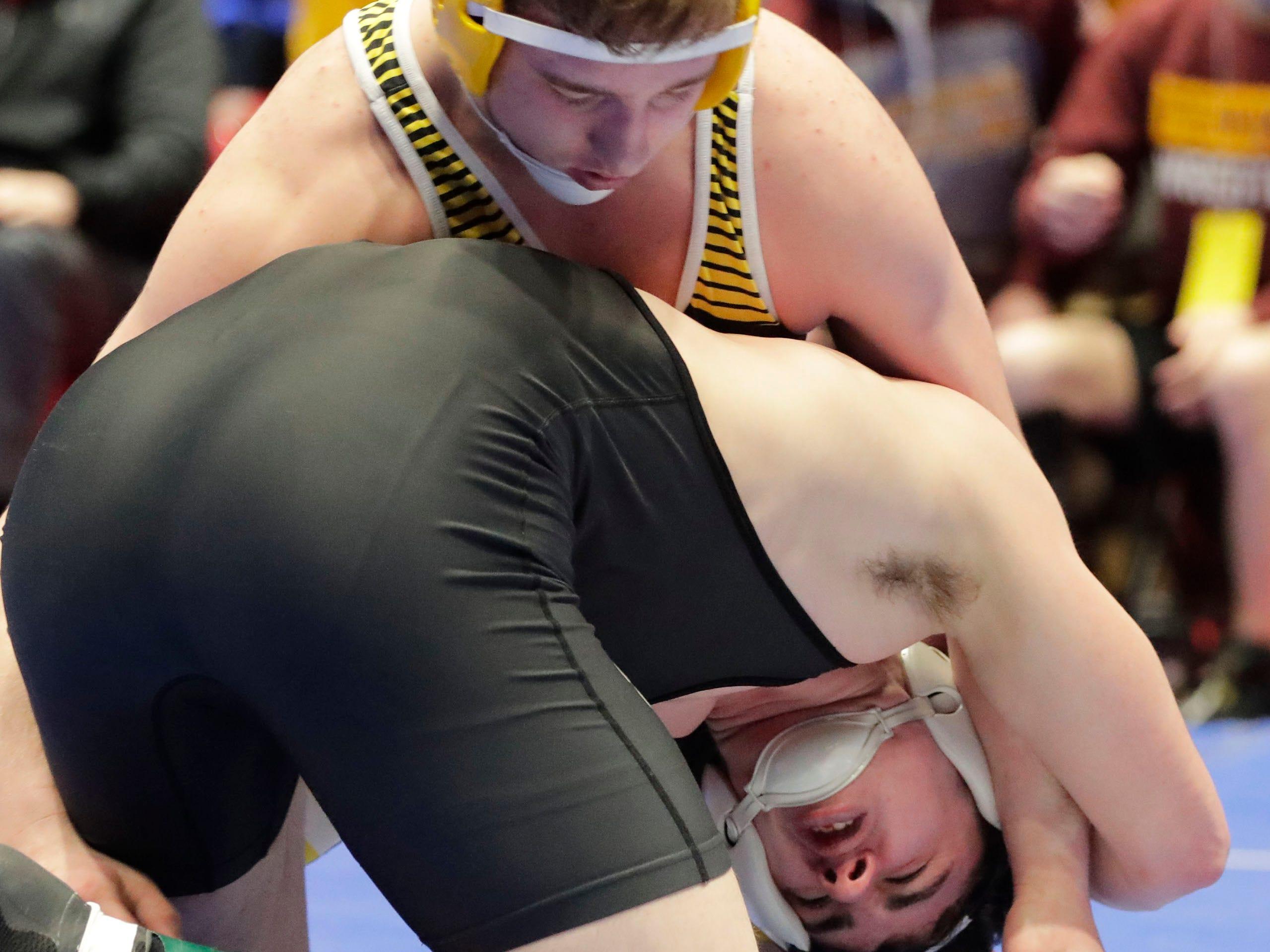 Stratford's Jediah Knetter, bottom, wrestles Fennimore's Logan Klass in the 195-pound class, Saturday, March 2, 2019, in Madison, Wis.