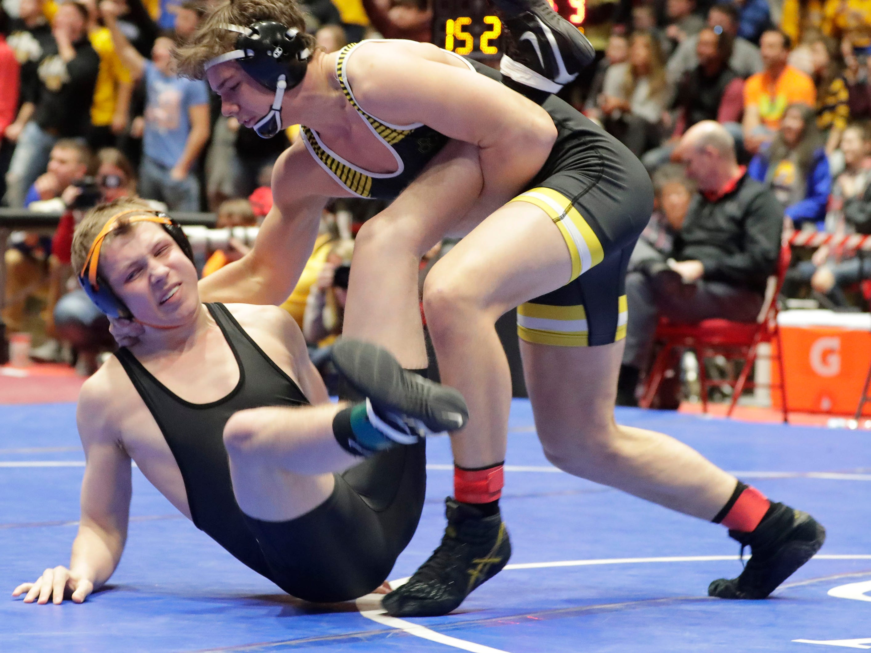Stratford's Hunter Ford, left, grimaces as he lands by Fennimore's Will Ahnen in the 182-pound class, Saturday, March 2, 2019, in Madison, Wis.