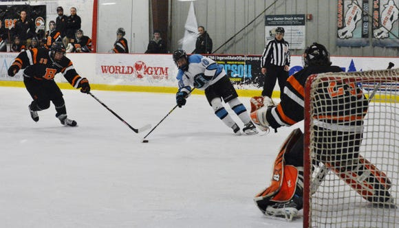 Suffern forward Tom McCarren gets a shot off in the first period of a NYSPHSAA regional championship against Bethlehem on Saturday, March 2, 2019 at Brewster Ice Arena. The game was tied 3-3 after four overtime periods and the Mounties won in the second round of a shootout.