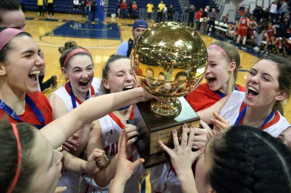 Tappan Zee players celebrate with the gold ball after defeating Somers 45-44 in the Section 1 Class A championship game at Pace University in Pleasantville March 2, 2019.