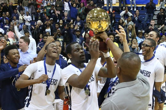 Poughkeepsie players celebrate with the gold ball after defeating Tappan Zee 47-42 in the Section 1 Class A championship game at Pace University in Pleasantville March 2, 2019.